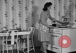 Image of housewife in 1930s United States USA, 1938, second 23 stock footage video 65675041917