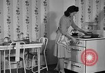 Image of housewife in 1930s United States USA, 1938, second 24 stock footage video 65675041917