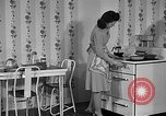 Image of housewife in 1930s United States USA, 1938, second 25 stock footage video 65675041917