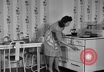 Image of housewife in 1930s United States USA, 1938, second 27 stock footage video 65675041917