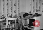 Image of housewife in 1930s United States USA, 1938, second 28 stock footage video 65675041917