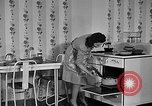 Image of housewife in 1930s United States USA, 1938, second 33 stock footage video 65675041917