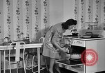Image of housewife in 1930s United States USA, 1938, second 34 stock footage video 65675041917