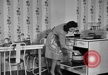 Image of housewife in 1930s United States USA, 1938, second 35 stock footage video 65675041917