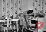 Image of housewife in 1930s United States USA, 1938, second 36 stock footage video 65675041917