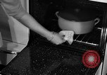 Image of housewife in 1930s United States USA, 1938, second 39 stock footage video 65675041917