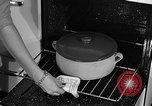 Image of housewife in 1930s United States USA, 1938, second 40 stock footage video 65675041917