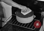 Image of housewife in 1930s United States USA, 1938, second 41 stock footage video 65675041917