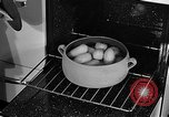 Image of housewife in 1930s United States USA, 1938, second 42 stock footage video 65675041917