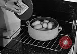 Image of housewife in 1930s United States USA, 1938, second 43 stock footage video 65675041917