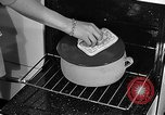 Image of housewife in 1930s United States USA, 1938, second 44 stock footage video 65675041917