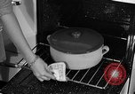 Image of housewife in 1930s United States USA, 1938, second 45 stock footage video 65675041917