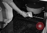 Image of housewife in 1930s United States USA, 1938, second 46 stock footage video 65675041917