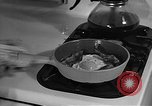 Image of housewife in 1930s United States USA, 1938, second 54 stock footage video 65675041917
