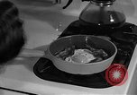 Image of housewife in 1930s United States USA, 1938, second 57 stock footage video 65675041917