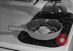 Image of housewife in 1930s United States USA, 1938, second 61 stock footage video 65675041917