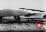 Image of Germans resupply defensive forces on beach by cargo gliders, during Wo Italy, 1943, second 43 stock footage video 65675041934