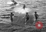 Image of surf board Winter Haven Florida USA, 1931, second 14 stock footage video 65675041976