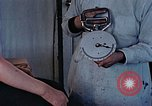 Image of operating an arm Hiroshima Japan, 1946, second 27 stock footage video 65675042175