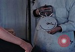 Image of operating an arm Hiroshima Japan, 1946, second 28 stock footage video 65675042175