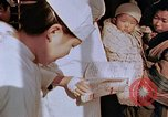 Image of atomic bomb victims receive medical treatment Hiroshima Japan, 1946, second 48 stock footage video 65675042179