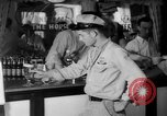 Image of Schepps Beer offered at special price of 60 cents an hour Dallas Texas United States USA, 1935, second 15 stock footage video 65675042250