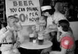 Image of Schepps Beer offered at special price of 60 cents an hour Dallas Texas United States USA, 1935, second 21 stock footage video 65675042250