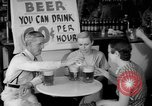 Image of Schepps Beer offered at special price of 60 cents an hour Dallas Texas United States USA, 1935, second 25 stock footage video 65675042250