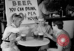 Image of Schepps Beer offered at special price of 60 cents an hour Dallas Texas United States USA, 1935, second 26 stock footage video 65675042250