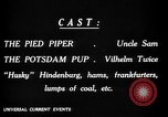 Image of Animated Uncle Sam as Pied Piper United States USA, 1918, second 23 stock footage video 65675042476