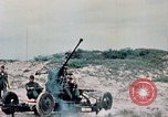 Image of 37 mm automatic air defense gun Vietnam, 1968, second 20 stock footage video 65675042706