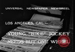 Image of unicycle Los Angeles California USA, 1933, second 3 stock footage video 65675042743