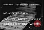 Image of unicycle Los Angeles California USA, 1933, second 8 stock footage video 65675042743