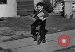 Image of unicycle Los Angeles California USA, 1933, second 17 stock footage video 65675042743