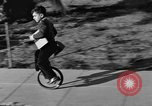 Image of unicycle Los Angeles California USA, 1933, second 24 stock footage video 65675042743