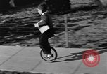 Image of unicycle Los Angeles California USA, 1933, second 25 stock footage video 65675042743
