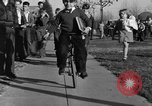 Image of unicycle Los Angeles California USA, 1933, second 32 stock footage video 65675042743