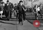 Image of unicycle Los Angeles California USA, 1933, second 36 stock footage video 65675042743