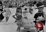 Image of American children parade in costume Ocean Park California USA, 1935, second 9 stock footage video 65675042765