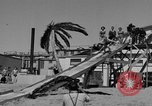 Image of ice covered slide Venice Beach Los Angeles California USA, 1938, second 43 stock footage video 65675042786