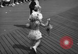 Image of children's parade on the boardwalk Ocean City New Jersey USA, 1939, second 35 stock footage video 65675042797