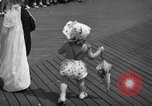 Image of children's parade on the boardwalk Ocean City New Jersey USA, 1939, second 37 stock footage video 65675042797