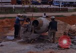 Image of mixing cement Thailand, 1966, second 20 stock footage video 65675042839