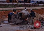 Image of mixing cement Thailand, 1966, second 22 stock footage video 65675042839