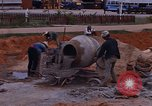 Image of mixing cement Thailand, 1966, second 23 stock footage video 65675042839