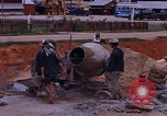 Image of mixing cement Thailand, 1966, second 33 stock footage video 65675042839