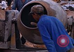 Image of mixing cement Thailand, 1966, second 47 stock footage video 65675042839