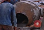 Image of mixing cement Thailand, 1966, second 52 stock footage video 65675042839