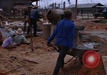 Image of mixing cement Thailand, 1966, second 59 stock footage video 65675042839