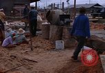 Image of mixing cement Thailand, 1966, second 60 stock footage video 65675042839